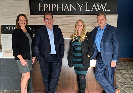 The partners at Epiphany Law, LLC bring diverse experience to meet their clients' legal needs. Pictured left to right: Heather Macklin, Rob Macklin, Kathryn M. Blom and Kevin L. Eismann (Managing Partner).